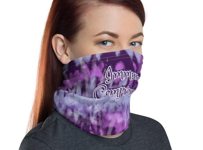 Neck gaiter, tie dye purple with text Immunocompromised