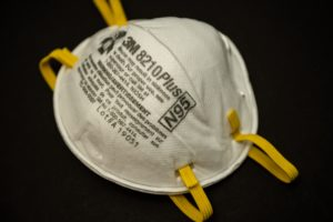 Example of a real N95 mask made by 3M. Note the head straps and proper labeling.