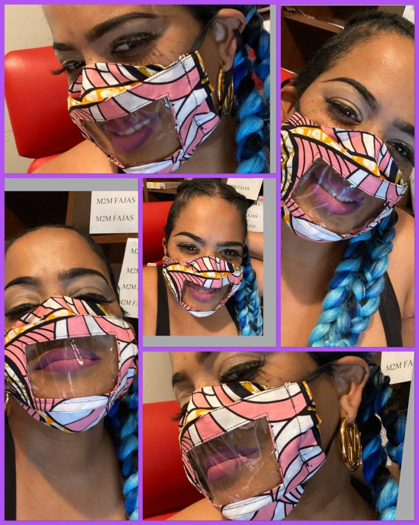 Fashionable pink and white fabric mask with clear window for lip reading, perfect for teachers and speech therapists.