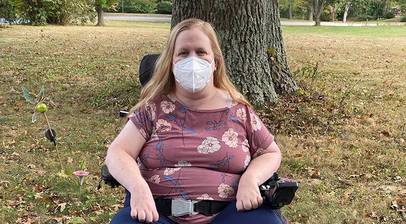 Karin wearing a KN95 mask.